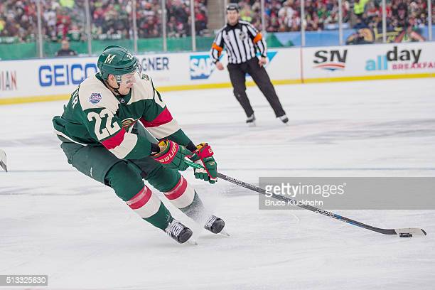 Nino Niederreiter of the Minnesota Wild skates with the puck against the Chicago Blackhawks during the 2016 Coors Light NHL Stadium Series on...