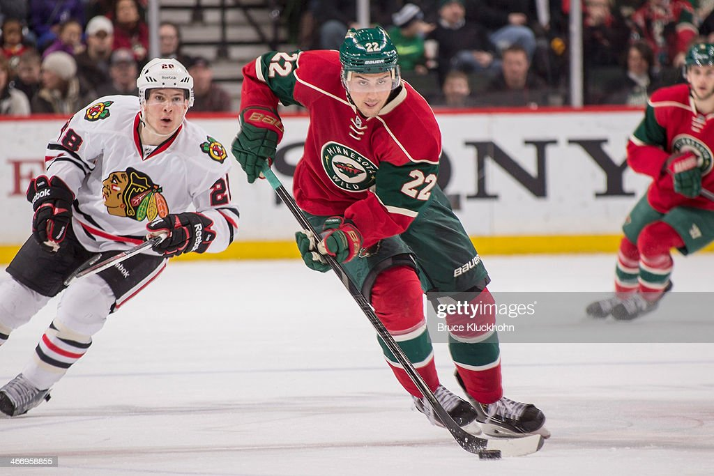 Nino Niederreiter of the Minnesota Wild skates with the puck during the game against the Chicago Blackhawks on January 23 2014 at the Xcel Energy...