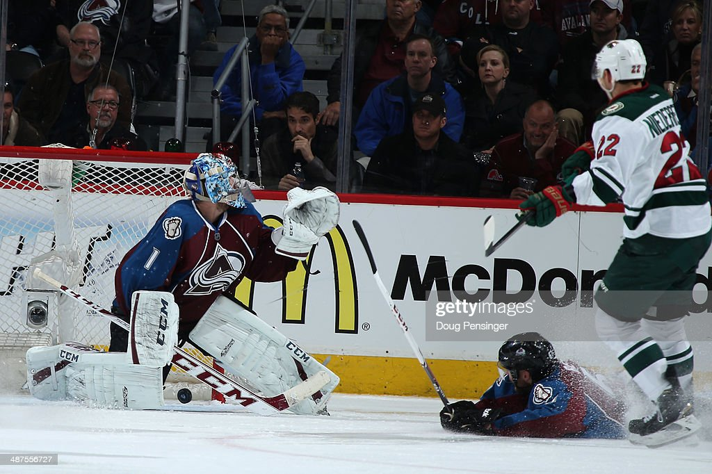 Nino Niederreiter of the Minnesota Wild watches his game winning goal against goalie Semyon Varlamov of the Colorado Avalanche in overtime of Game...