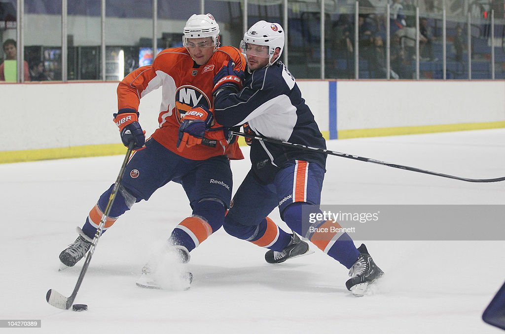 Nino Niederreiter of the New York Islanders is held up by Mark Streit during a training camp session at Iceworks on September 19 2010 in Syosset New...