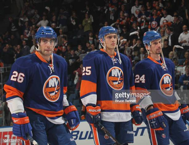 Nino Niederreiter of the New York Islanders lines up between Matt Moulson and Radek Martinek before playing in his first NHL game against the Dallas...