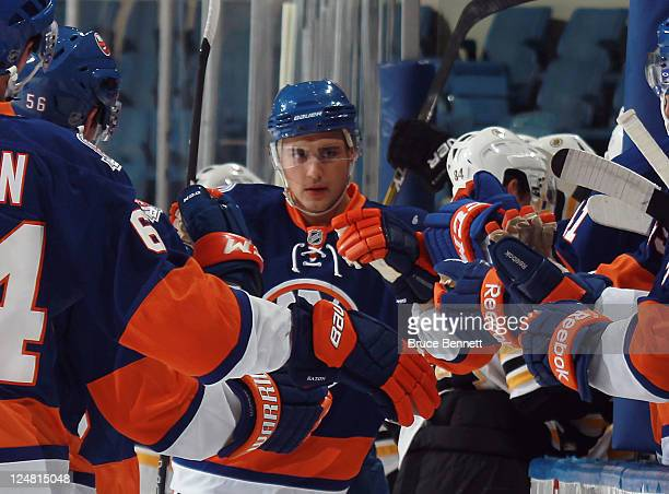Nino Niederreiter of the New York Islanders returns to the bench after scoring at 902 of the first period against the Boston Bruins during a rookie...