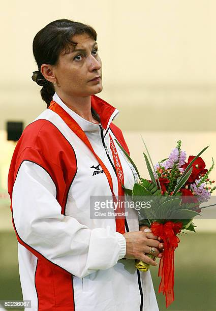 Nino Salukvadze of Georgia looks on with her bronze medal in the women's 10m air pistol final shooting event held at the Beijing Shooting Range Hall...