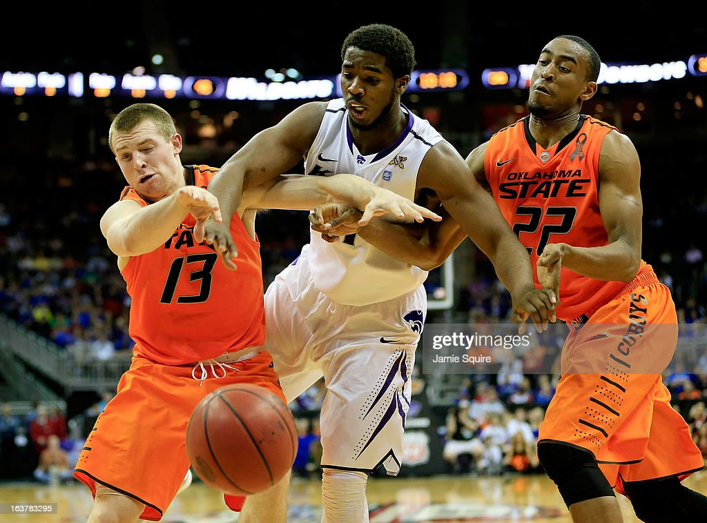 Nino Williams #11 of the Kansas State Wildcats battles for control of the ball against Phil Forte #13 and Markel Brown #22 of the Oklahoma State Cowboys in the second half during the Semifinals of the Big 12 basketball tournament at the Sprint Center on March 15, 2013 in Kansas City, Missouri.