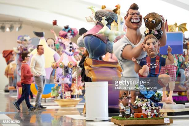 A 'Ninot' caricature of Cristiano Ronaldo and Lionel Messi is displayed during the Ninot exhibition ahead of Las Fallas Festival at Museo de Las...