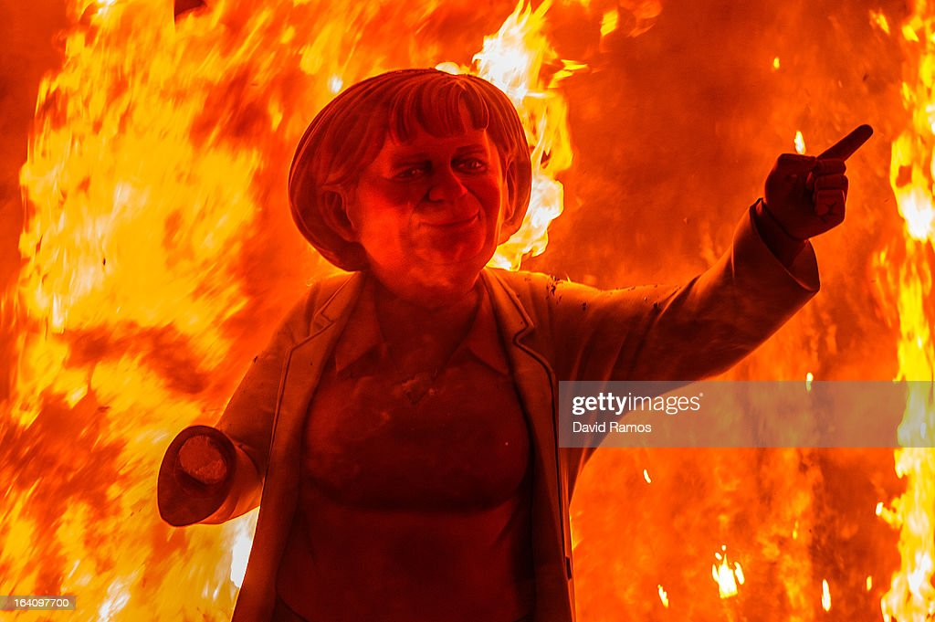 A 'Ninot' (puppet) depicting German Cancellor Angela Merkel burns during the last day of the Las Fallas Festival on March 20, 2013 in Valencia, Spain. The Fallas festival, which runs from March 15 until March 19, celebrates the arrival of spring with fireworks, fiestas and bonfires made by large puppets named Ninots.