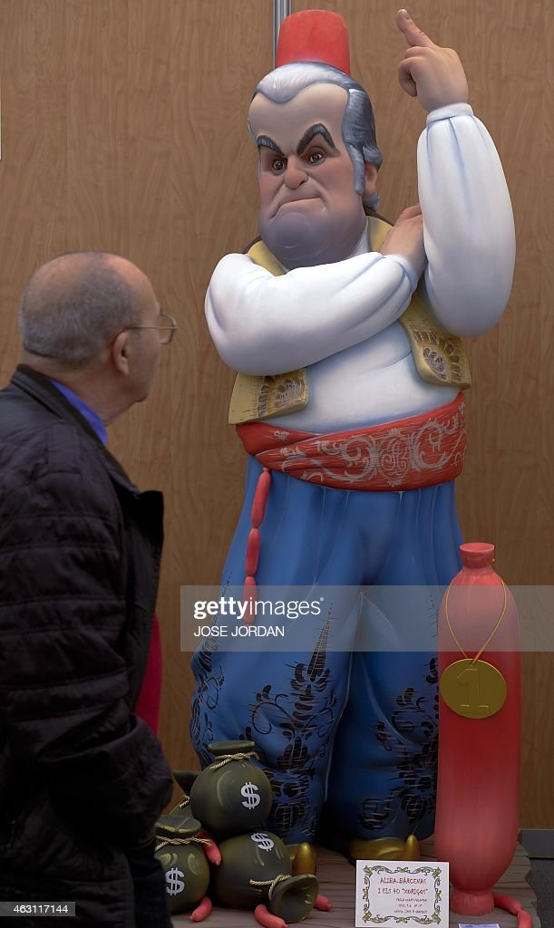 A ninot (individual figure making up the scenes in the Fallas celebration) of Former-treasurer of Spain's ruling party Luis Barcenas is displayed during the Ninot exhibition in Valencia on February 10, 2015. The Fallas will be burned in the streets of Valencia on March 19, 2015 as a tribute to Saint Joseph, the saint patron of the carpenters' guild.