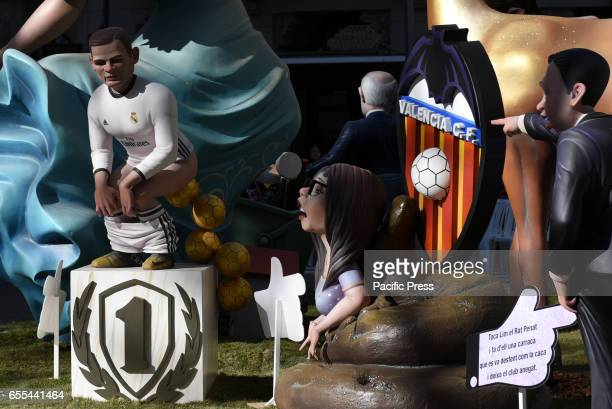 A 'ninot' representing Cristiano Ronaldo left is displayed during the 'Fallas' Festival The Fallas is a traditional celebration held in commemoration...
