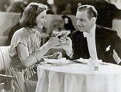 Ninotchka and Count Leon d'Algout share a toast in the 1939 MGM production Ninotchka