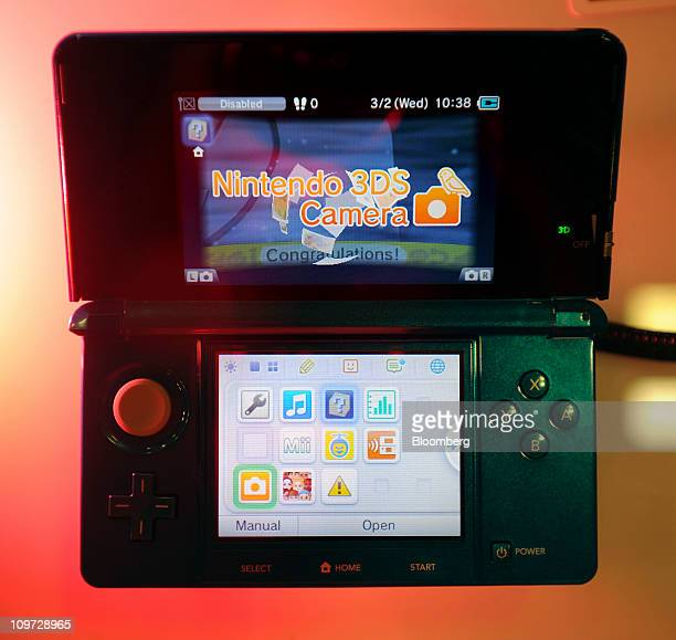 A Nintendo Co 3DS handheld video gameplayer sits on display at a game developers conference in San Francisco California US on Wednesday March 2 2011...