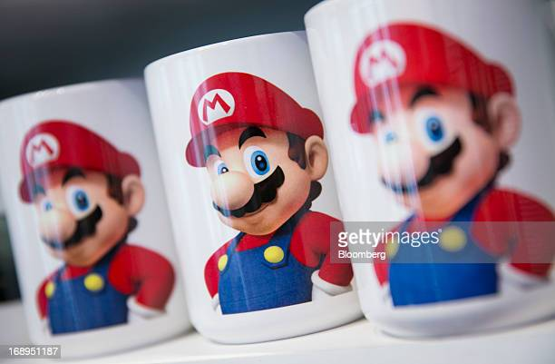 Nintendo Co's Super Mario is displayed on coffee mugs for sale at the Nintendo World store in New York US on Friday May 17 2013 Nintendo Co maker of...