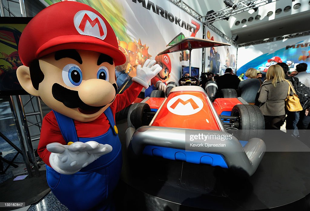 Nintendo game character Mario stands next to the new gamer-themed car built by West Coast Customs on November 17, 2011 in Los Angeles, California. The car show opens to the public tomorrow and runs through November 27.