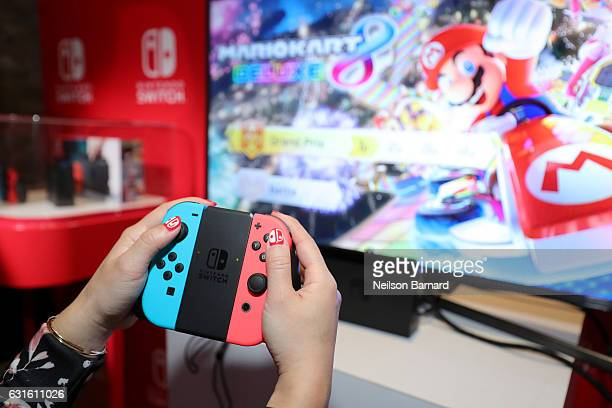 Nintendo of America A guest enjoys playing Mario Kart 8 Deluxe on the groundbreaking new Nintendo Switch at a special preview event in New York on...