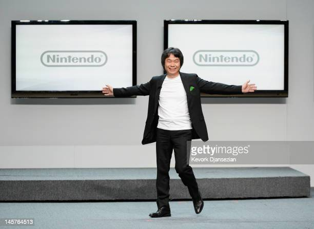 Nintendo producer Shigeru Miyamoto who created Super Mario Bros speaks during a press conference for Nintendo's new hand held game console Wii U at...
