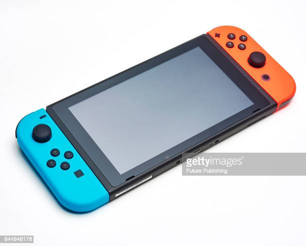 A Nintendo Switch console with a pair of JoyCon controllers taken on February 22 2017