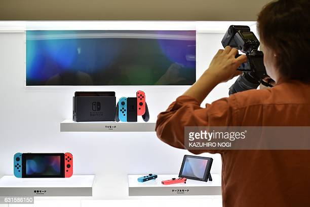 Nintendo's new video game console Switch is displayed at a presentation in Tokyo on January 13 2017 Nintendo on January 13 unveiled its new Switch...
