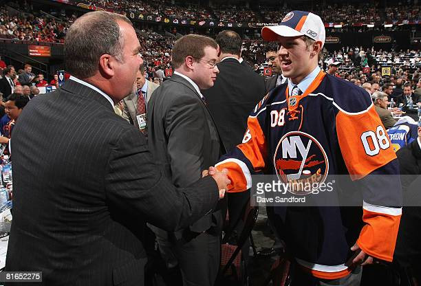 Ninth overall pick Josh Bailey of the New York Islanders greets team personnel during the 2008 NHL Entry Draft at Scotiabank Place on June 20 2008 in...