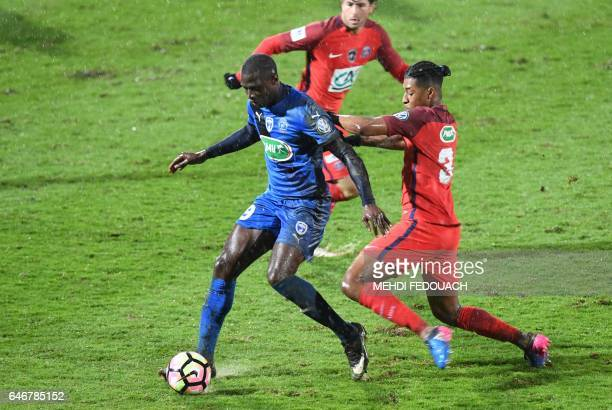 Niort's forward Ande Dona vies with Paris SaintGermain's French defender Presnel Kimpembe during the French Cup football match between Niort and PSG...