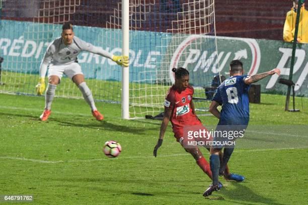 Niort's midfielder Jimmy Roye kicks the ball in front Paris SaintGermain's French defender Presnel Kimpembe under the look of Paris SaintGermain's...
