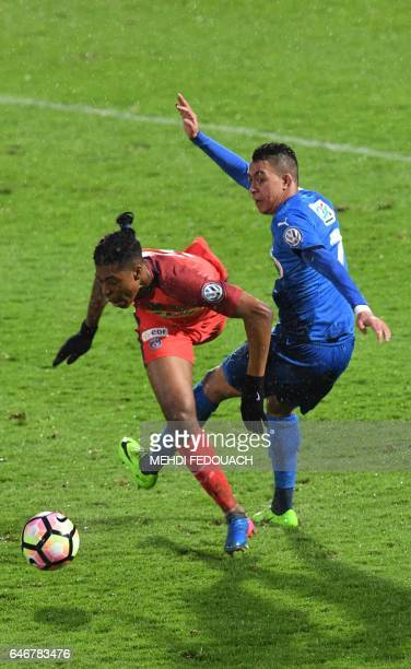 Niort's ZGrich Zakaria Grich vies with Paris SaintGermain's French defender Presnel Kimpembe during the French Cup football match between Niort and...
