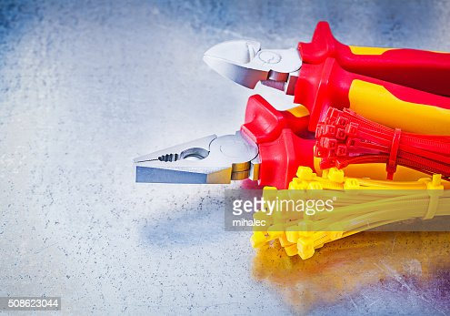 Nippers pliers self-locking cable ties on metallic background co : Stock Photo