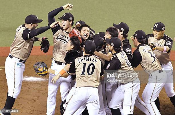 Nippon Ham Fighters ace pitcher Shohei Otani expresses joy with his teammates as his team clinched the Pacific League pennant at Seibu Prince Dome...