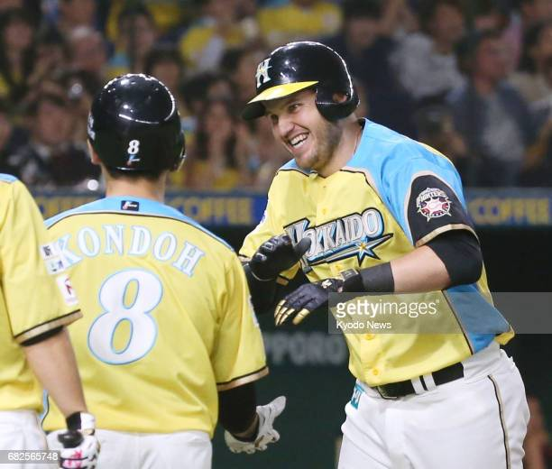 Nippon Ham Fighters' Brandon Laird is congratulated by his teammates after hitting a tworun homer in the third inning against the Lotte Marines at...