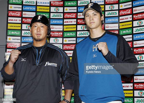 Nippon Ham Fighters first baseman Sho Nakata and pitcherdesignated hitter Shohei Otani pose for a photo at Sapporo Dome on June 27 after being...
