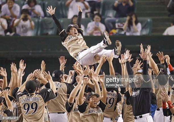 Nippon Ham Fighters manager Hideki Kuriyama is thrown into the air as his team clinched the Pacific League pennant at Seibu Prince Dome near Tokyo on...