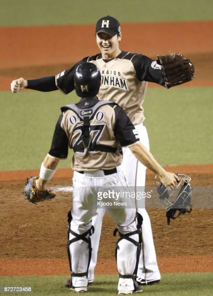 Nippon Ham Fighters pitcher Shohei Otani and catcher Shota Ono celebrate after clinching the Pacific League title with a 10 win over the Seibu Lions...