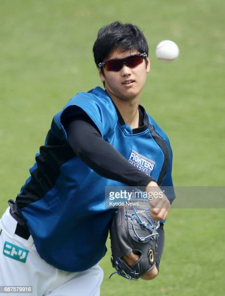 Nippon Ham Fighters pitcherdesignated hitter Shohei Otani plays catch at the club's farm team facility in Kamagaya Chiba Prefecture on May 24 2017...
