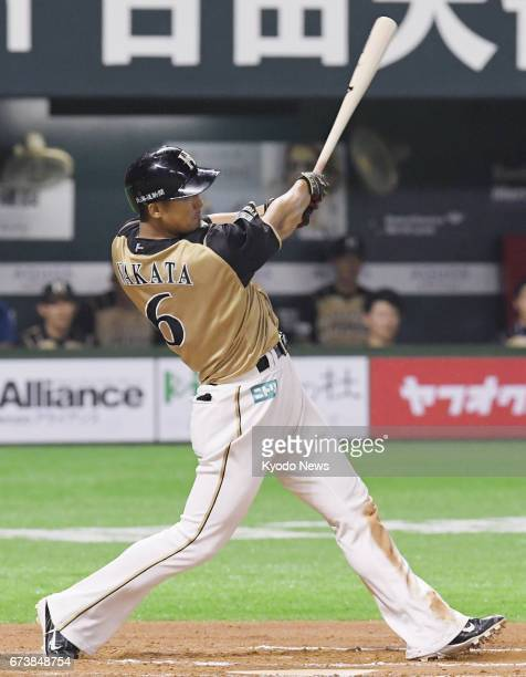 Nippon Ham Fighters slugger Sho Nakata hits a threerun homer over the leftcenter fence in the 10th inning of a game against Softbank Hawks in Fukuoka...