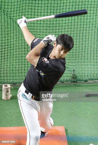 Nippon Ham Fighters' twoway star Shohei Otani practices batting during a firstteam training session at Sapporo Dome in Sapporo on June 20 2017 Otani...