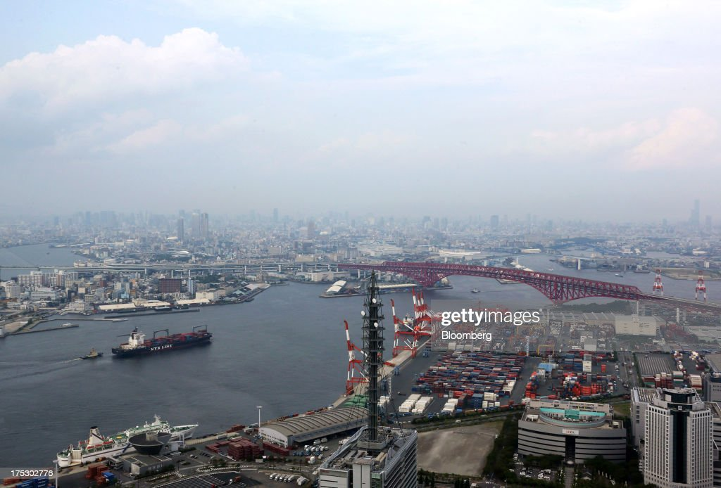 A Nippon Yusen K.K. container ship, left, sails into Osaka Bay in Osaka, Japan, on Thursday, Aug. 1, 2013. Prime Minister Shinzo Abe's administration plans to release later this year its medium-term fiscal plans and a final decision on a two-step doubling of the consumption levy to 10 percent in 2015. Photographer: Tomohiro Ohsumi/Bloomberg via Getty Images