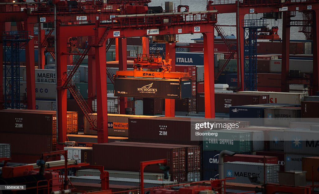 A Nippon Yusen K.K. shipping container is moved with a crane at the Yangshan Deep Water Port, part of China (Shanghai) Pilot Free Trade Zone's Yangshan free trade port area, at dusk in Shanghai, China, on Wednesday, Oct. 23, 2013. The area is a testing ground for free-market policies that Premier Li Keqiang has signaled he may later implement more broadly in the world's second-largest economy. Photographer: Tomohiro Ohsumi/Bloomberg via Getty Images