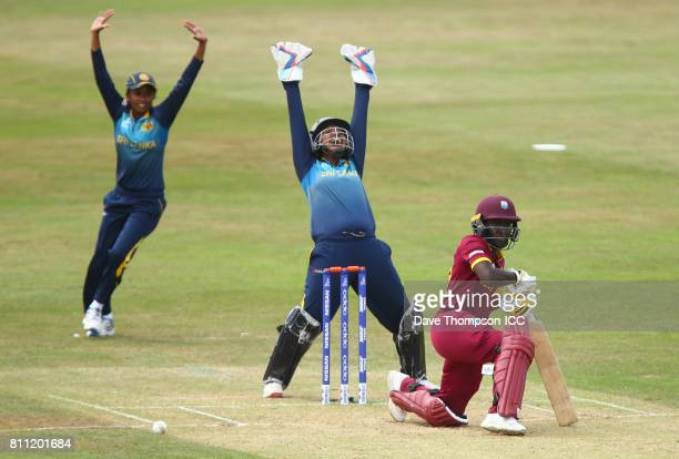 Nipuni Hansika of Sri Lanka and Prasadani Weerakkodi of Sri Lanka appeal successfully for the wicket of Kycia Knight of West Indies during the ICC...