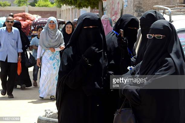 Niqabclad Egyptian women queue outside a polling station in the Mediterranean city of Alexandria on May 24 2012 Egyptians swarmed polling stations on...