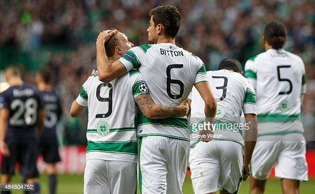 Nir Bitton of Celtic celebrates with teammate Leigh Griffiths after scoring his team's second goal during the UEFA Champions League Qualifying Round...
