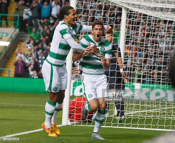Nir Bitton of Celtic celebrates with teammate Virgil van Dijk after scoring his team's second goal during the UEFA Champions League Qualifying Round...