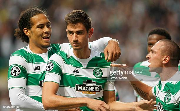 Nir Bitton of Celtic celebrates with teammates Virgil van Dijk and Scott Brown after scoring his team's second goal during the UEFA Champions League...