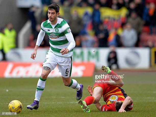 Nir Bitton of Celtic challenges Sean Welsh of Patrick Thistle during the Ladbrokes Scottish Premiership match between Patrick Thistle FC and Celtic...