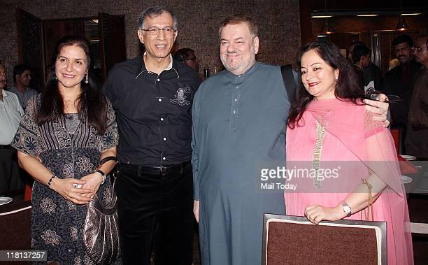 Niranjan Hiranandani with wife Kamal and Nitin Mukesh with wife Nishi at the launch of 'Spaghetti' restaurant at Khar in Mumbai on July 3 2011