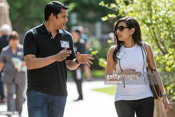 Nirav Tolia chief executive officer of Nextdoorcom Inc left and his wife Megha Tolia walk the grounds after a morning session during the Allen Co...