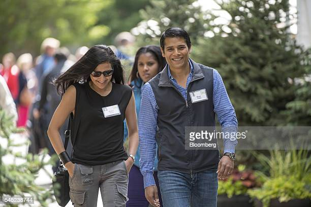 Nirav Tolia cofounder and chief executive officer of Nextdoorcom Inc right walks the grounds after the morning session of the Allen Co Media and...