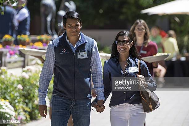 Nirav Tolia cofounder and chief executive officer of Nextdoorcom Inc left walks the grounds after the morning sessions during the Allen Co Media and...