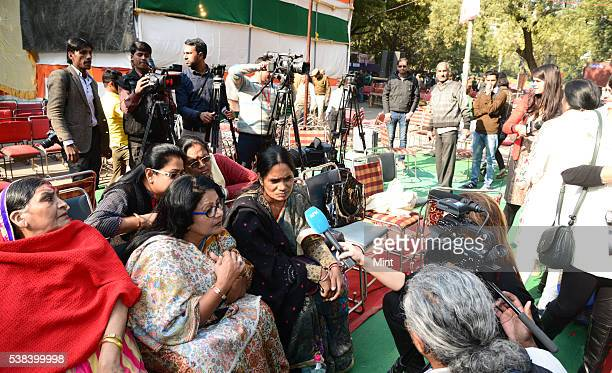 Nirbhayas Mother Asha Devi at Jantar Mantar lights a candle remembering her daughter on December 16 2015 in New Delhi India
