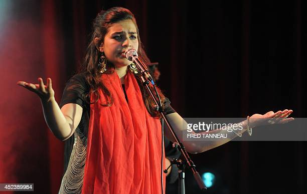 Nirmaan's Rajasthan singer Parveen Sabrina Khan performs on July 19 2014 during the 23rd Festival des Vieilles Charrues in CarhaixPlouguer western...