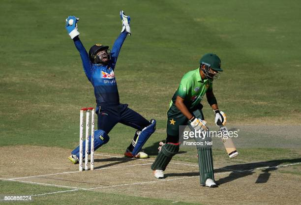 Niroshan Dickwella of Sri Lanka appeals for the wicket of Babar Azam of Pakistan during the first One Day International match between Pakistan and...
