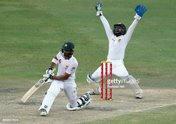 Niroshan Dickwella of Sri Lanka appeals for the wicket of Shan Masood during Day Four of the Second Test between Pakistan and Sri Lanka at Dubai...