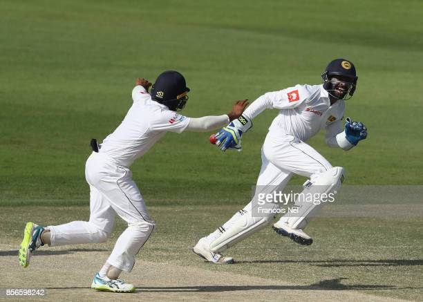 Niroshan Dickwella of Sri Lanka celebrates after dismissing Sarfraz Ahmed of Pakistan during Day Five of the First Test between Pakistan and Sri...